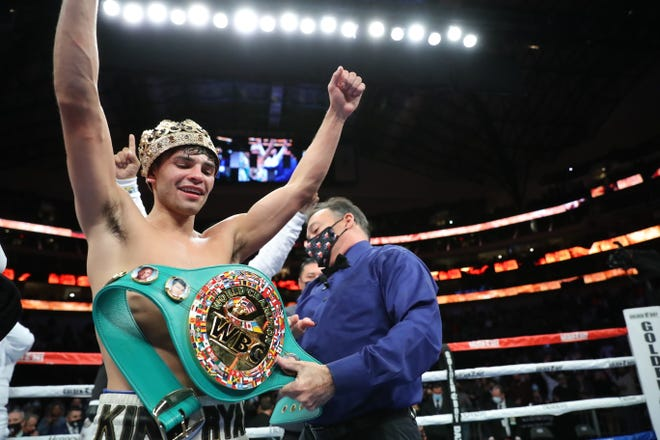 Ryan Garcia raises his arms in victory after beating Luke Campbell for the interim WBC lightweight title Saturday night in Dallas, Texas.