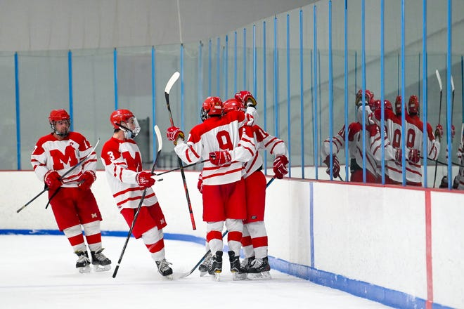 Melrose hockey players celebrate a goal during a game versus Stoneham at the Stoneham Arena on Sunday, Jan. 3. The Red Raiders have only lost one game since the shortened pandemic season started just after New Year's, and as a result of their success they have qualified for the Middlesex League postseason tournament this week.