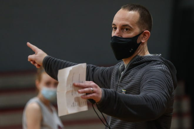 Millis High head coach Dave Fallon speaks with players during the girls varsity basketball practice at Millis High School on Jan. 2, 2021.