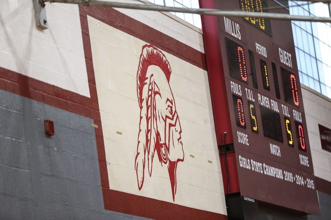Millis High's Mohawk mascot painted next to the scoreboard in the school gym during girls varsity basketball practice at Millis High School, Jan. 2.