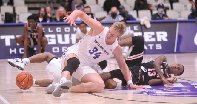 ACU's Kolton Kohl (34) eyes the ball after teammate Damien Daniels knocked the ball loose from Lamar's Davion Buster (13). ACU beat the Cardinals 83-65 in the Southland Conference opener for both teams Saturday at the Teague Center.
