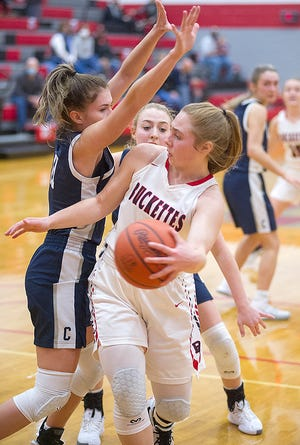 Buckeye Central's Claudia Pifher passes around the Carey defense.