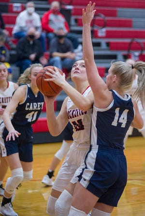 Buckeye Central's Julia Evak looks to the basket while guarded by Carey's Avarie Stewart.
