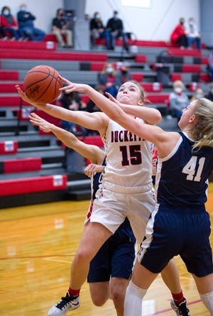 Buckeye Central's Taylor Ratliff attempts a shot over Carey's Sadie Arend.