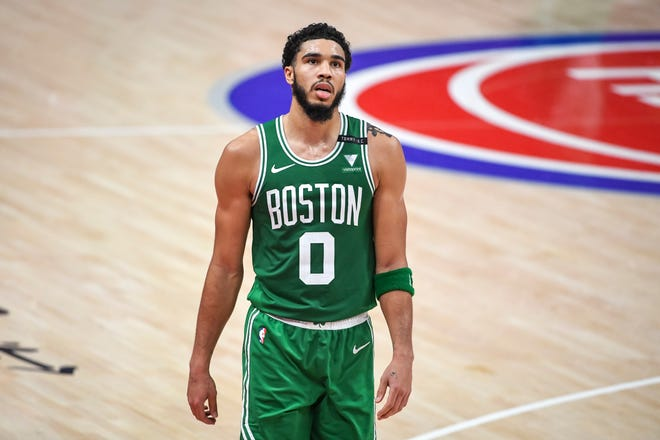 Jayson Tatum of the Boston Celtics looks on during the fourth quarter against the Detroit Pistons at Little Caesars Arena, Jan. 3, 2021. On Friday, Tatum tested positive for the coronavirus.