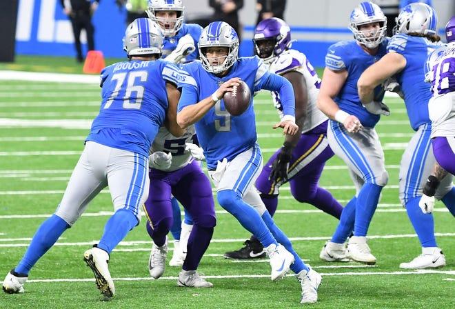 Gelandang singa, Matthew Stafford, melakukan tiga operan touchdown dalam kekalahan hari Minggu dari Viking.