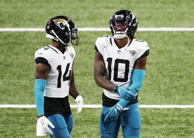 Jaguars wide receivers Terry Godwin (14) and Laviska Shenault (10) talk before Sunday's game at Indianapolis. Both made key contributions to the Jags offense.