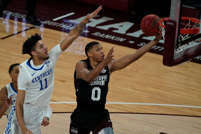 Mississippi State forward Jalen Johnson (0) makes a layup past Kentucky guard Dontaie Allen (11) during the first half of an NCAA college basketball game in Starkville, Miss., Saturday, Jan. 2, 2021. (AP Photo/Rogelio V. Solis)