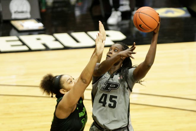 Purdue center Fatou Diagne (45) goes up for a shot above Michigan State forward Taiyier Parks (14) during the third quarter of an NCAA women's basketball game, Sunday, Jan. 3, 2021 at Mackey Arena in West Lafayette.