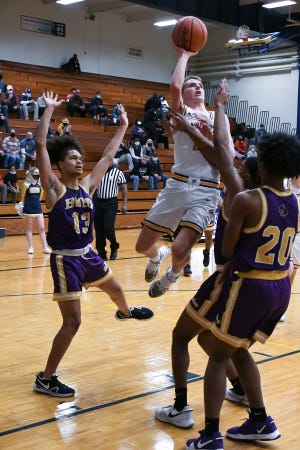 Lancaster senior Cameron Roudabush shoots a lay up Saturday afternoon at LHS. Reynoldsburg defeated the Golden Gales 65-44.