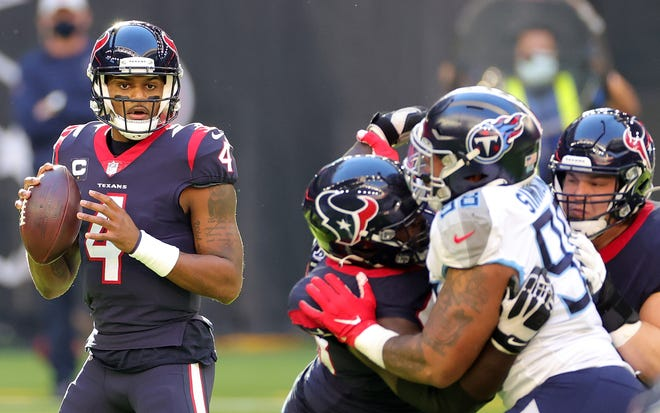 Deshaun Watson (4) of the Houston Texans drops back to pass during the first half against the Tennessee Titans at NRG Stadium on January 03, 2021 in Houston, Texas.