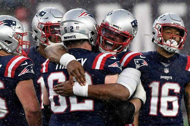Patriots quarterback Cam Newton hugs offensive guard Joe Thuney (62) late in the game against the Jets on Sunday. The game was meaningless in the standings as both teams had already been eliminated from the playoffs.