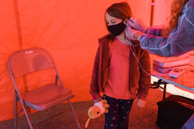 Lydia Mireles receives a hearing test at an Alamogordo Public Schools health services event in Alamogordo on Saturday, Jan. 2, 2021.
