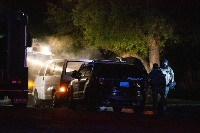 Police set off a device that appears to be tear gas to end a standoff with a man inside his vehicle in Palm Springs Calif., on January 3, 2020.