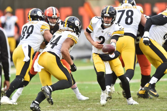 Pittsburgh Steelers quarterback Mason Rudolph (2) hands off the ball during the second half of an NFL football game against the Cleveland Browns, Sunday, Jan. 3, 2021, in Cleveland. (AP Photo/David Richard)
