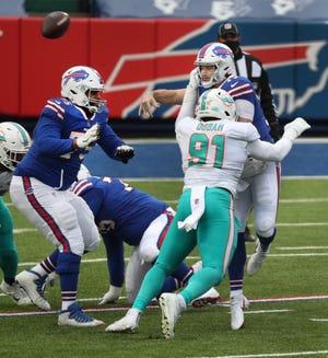 Dolphins defensive end Emmanuel Ogbah pressures Bills quarterback Josh Allen during Sunday's season-ending loss.