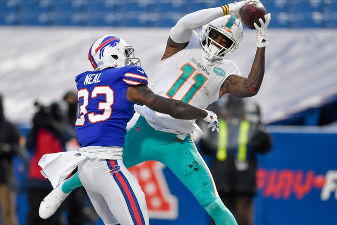 Dolphins receiver DeVante Parker makes a catch against Buffalo's Siran Neal last season.