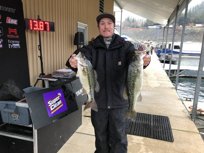 Logan McDaniel, 34 of Oroville holds up with his winning spotted bass at the sixth annual Wild West Bass Trail Team Tournament at Lake Shasta on Jan. 2, 2021.