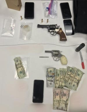 Two unregistered revolvers, narcotics and cash seized during an investigation on New Year's Eve in Oxnard.