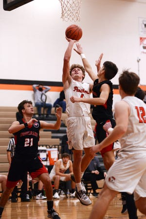 Logyn Ratliff goes up for a shot in the lane during the third quarter of New Lexington's 50-31 win against visiting Rosecrans on Saturday night.