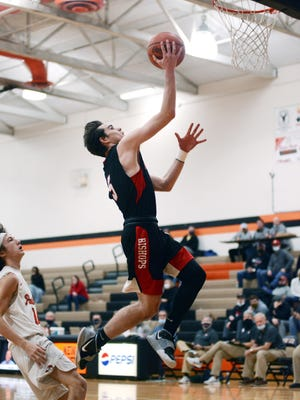Rosecrans' Thomas Spohn soars into the lane against New Lexington in a game earlier this season. Spohn and teammate Josh Merva made first team in the Mid-State League Cardinal Division.