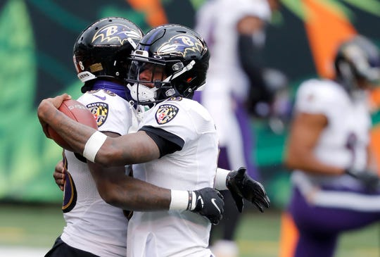 QB Lamar Jackson, right, and the Ravens are once again playoff bound.