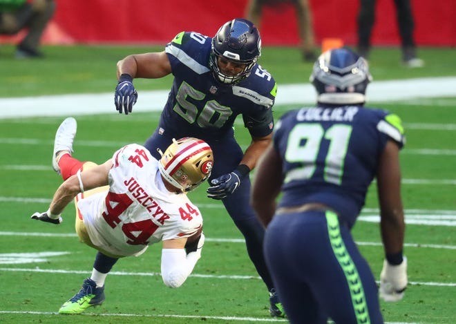San Francisco 49ers fullback Kyle Juszczyk (44) is brought down by Seattle Seahawks outside linebacker K.J. Wright (50) during the first half of a game last season at State Farm Stadium. Wright could be a free-agent option for the Patriots.