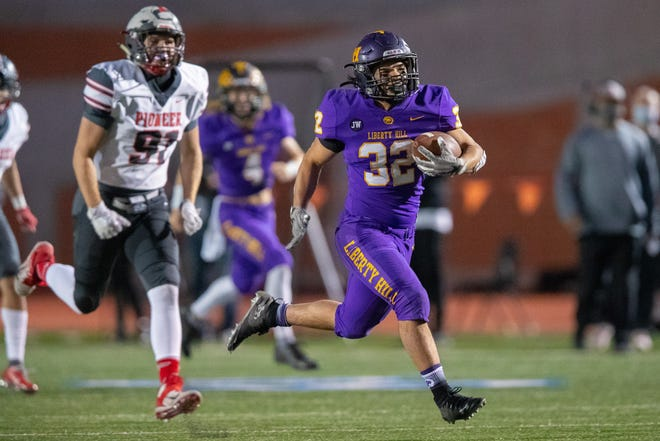 Liberty Hill running back Eric De La Cruz, racing for a touchdown against Mission Pioneer last week, was part of a trio that rushed for 710 yards in the game. The Panthers will take on Crosby in a Class 5A DII state semifinal Friday.