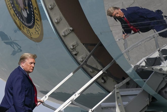 President Donald Trump boards Air Force One at Palm Beach International Airport, Thursday, Dec. 31, 2020, in West Palm Beach, Fla. Trump is returning to Washington after visiting his Mar-a-Lago resort. (AP Photo/Patrick Semansky)