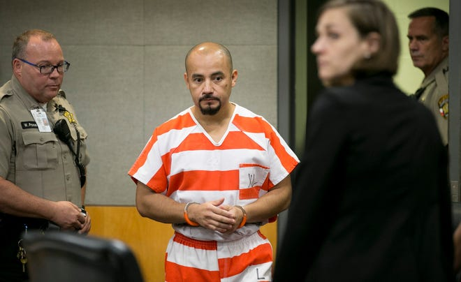 Areli Escobar enters the courtroom for a hearing to discuss his capital murder conviction at the Blackwell-Thurman Criminal Justice Center on June 27, 2018.