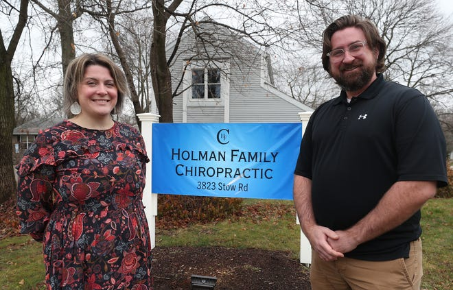 Amanda and Jeffrey Holman talk about their practice, Holman Family Chiropractic in Stow, Jan. 4 in Stow. The couple signed a lease in February, but had to delay its opening until November due to the pandemic. [Mike Cardew/Beacon Journal]