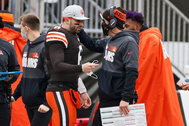 Browns quarterback Baker Mayfield, left, talks with coach Kevin Stefanski during Sunday's game against the Steelers in Cleveland.