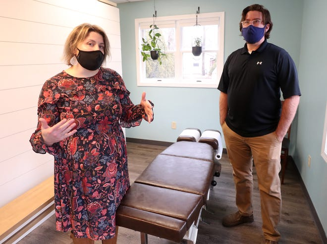 Amanda and Jeffrey Holman talk about their practice, Holman Family Chiropractic in Stow, on Monday, Jan. 4, 2021 in Stow. The couple signed a lease in February, but had to delay its opening until November due to the pandemic. [Mike Cardew/Beacon Journal]