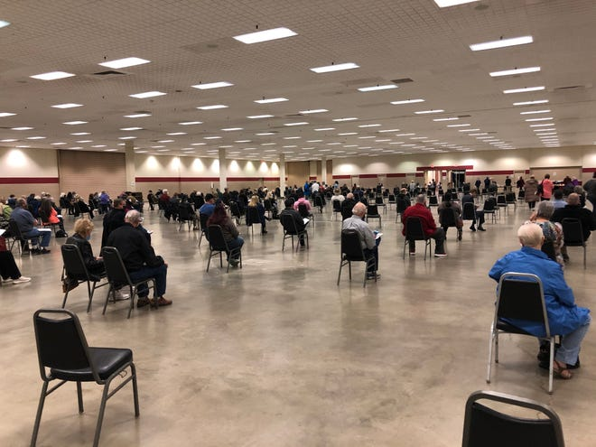 Members of the Amarillo community fill out paperwork prior to receiving the Moderna COVID-19 vaccine at the city's walk-in vaccination clinic at the Amarillo Civic Center Complex Monday afternoon.