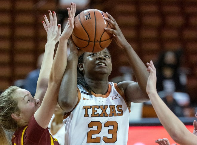 Texas forward DeYona Gaston (23) gets fouled by Iowa State's Kylie Feuerbach (10) in Austin on Jan. 3, 2021.