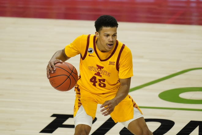 Iowa State guard Rasir Bolton looks to pass during the second half of an NCAA college basketball game against Baylor, Saturday, Jan. 2, 2021, in Ames, Iowa. Baylor won 76-65. (AP Photo/Charlie Neibergall)