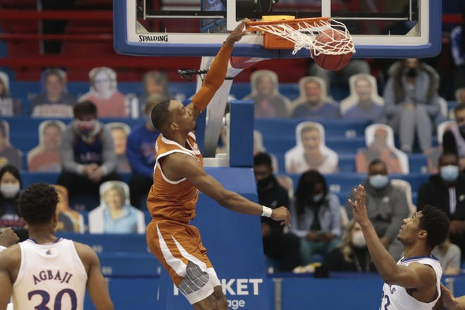 Texas guard Matt Coleman III dunks against Kansas in the second half of Saturday's 84-59 win in Lawrence. Texas, now 2-0 in Big 12 play, will host Iowa State on Tuesday.