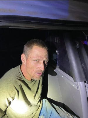 Johnston County deputies place Danny Ray Compton under arrest following a pursuit through Mill Creek in December.