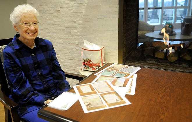 Donna Sanders poses with photos of the notes she has posted on her door at Brethren Care Village's Belmont Towers on Jan. 4, 2021. TOM E. PUSKAR/TIMES-GAZETTE.COM