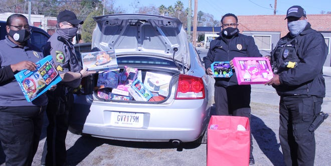 Wadley City officers and Police Chief Tommie Walker pose with some of the toys donated to the city's police department for the department's annual toy drive for children. Pictured (from left) are Wadley Clerk of Court Valarie Carlyle, Sgt. Jack Hancock, Walker and Sgt. Tyrone Tablada.