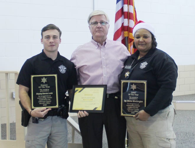 Jefferson County Sheriff Gary Hutchins (center) stands with Deputy of the Year, Dakota Lamb (at left), and Jailer of the Year, Sgt. Donna Worthington. Hutchins said jailers selected Worthington as Jailer of the Year; and, deputies selected Lamb as Deputy of the Year.
