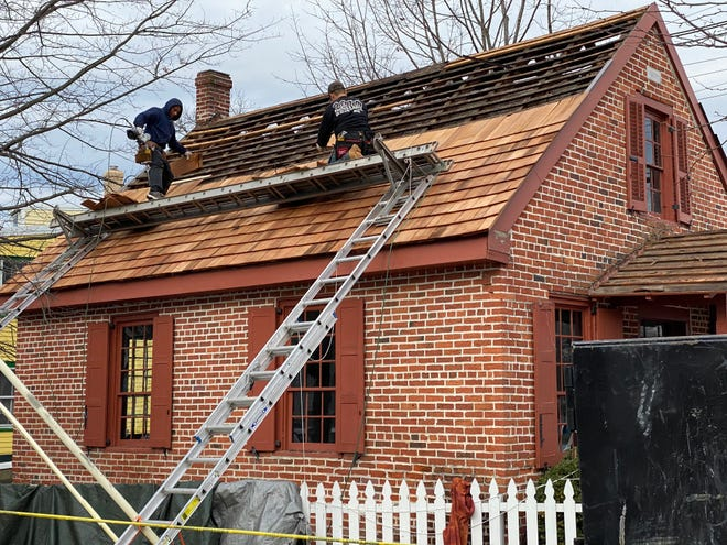 Trenton Roofing construction workers build the new roof at the Clara Barton Schoolhouse in Bordentown City. The workers completed the job in one day on Dec. 28.