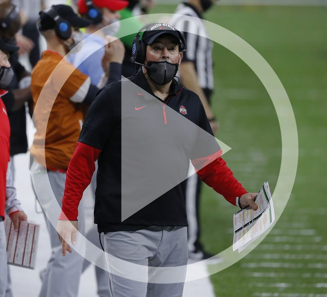 In this file photo, Ohio State Buckeyes head coach Ryan Day looks to the clock during the third quarter of the College Football Playoff semifinal against the Clemson Tigers at the Allstate Sugar Bowl in the Mercedes-Benz Superdome in New Orleans on Friday, Jan. 1, 2021. Ohio State won 49-28.