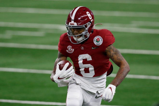 DeVonta Smith has 105 catches for 1,641 yards and 20 touchdowns this season.