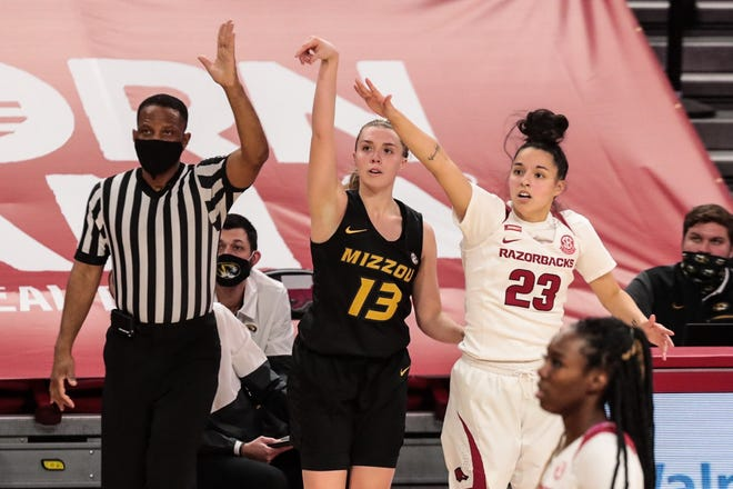 Missouri guard Haley Troup (13) releases a shot during a game against Arkansas on Sunday at Bud Walton Arena in Fayetteville, Ark.