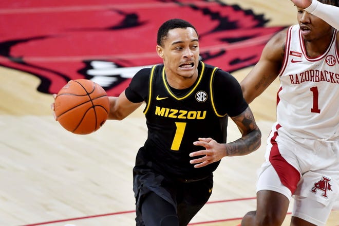 Missouri guard Xavier Pinson (1) dribbles against Arkansas during a game Saturday in Fayetteville, Ark. Missouri won 81-68.