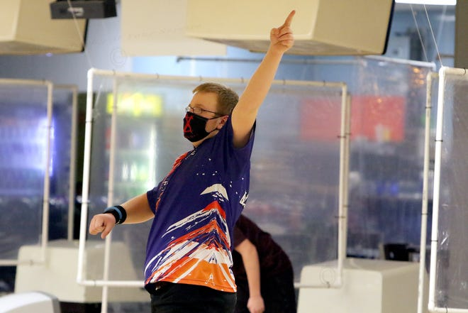 Penn Yan's Cameron Bassage reacts after bowling a strike.