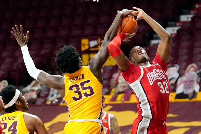 Minnesota's Isaiah Ihnen (35) blocks a shot-attempt by Ohio State's E.J. Liddell (32) in the second half of an NCAA college basketball game Sunday, Jan. 3, 2021, in Minneapolis.