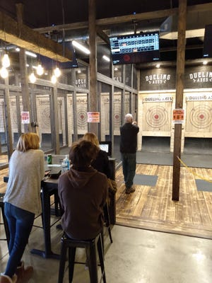 A customer tries his hand at Dueling Axes' newest location in New Albany