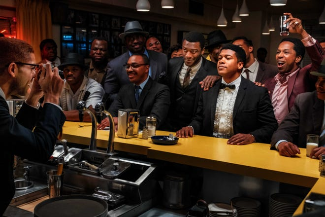 "Malcolm X (Kingsley Ben-Adir, at left) takes a picture of his friends Jim Brown (Aldis Hodge), Cassius Clay (Eli Goree) and Sam Cooke (Leslie Odom Jr.) in ""One Night in Miami."""